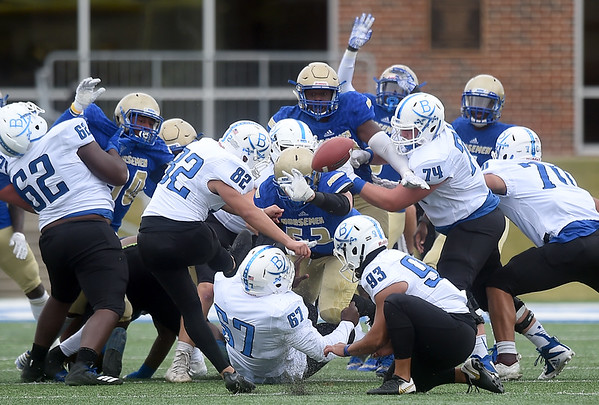 Northeastern A&M's  defnse blocks a field goal attempt by Blinn's Emerson Garcia (82) which was run back for an NEO touchdown during their game on Saturday afternoon at NEO.<br /> Globe | Laurie Sisk