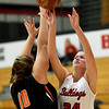 Carl Junction's Brett Chappel (24) shoots over the outstretched arms of Jasper's Katelyn Dockery (10) during their game on Wednesday night at CJHS.<br /> Globe | Laurie SIsk