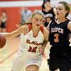 Carl Junction's Shila Winder (12) works to get past Jasper's Alexis Durman (3) during their game on Wednesday night at CJHS.<br /> Globe | Laurie SIsk