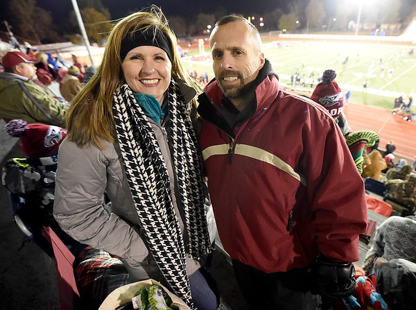 From the left: Brandi and Michael Landis pose for a photo from their seats at Junge Stadium before the start of the Eagles District Championship game on Friday.<br /> Globe | Laurie SIsk