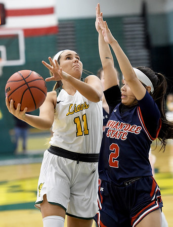 Missouri Southern's Amber Buch (11) drives the lane as Panhandle State's Taylor Acosta (2) defends during their game on Tuesday night at Leggett & Platt.<br /> Globe | Laurie Sisk