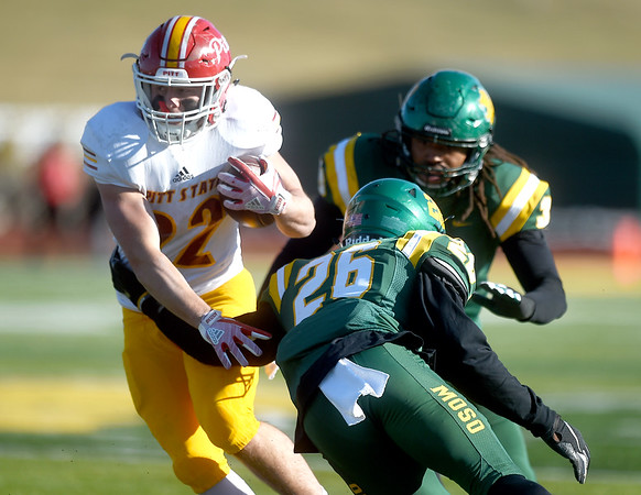 Pittsburg State's Tucker Horak (22) tries to get past Missouri Southern's John Ejizu (26)during their game on Saturday at Fred G. Hughes Stadium.<br /> Globe | Laurie Sisk