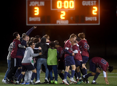The Joplin Eagles soccer team celebrates its Class 4 District 11 3-2 championship win over Springfield Central on Thursday night at JHS.  Globe | Laurie Sisk