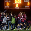 The Joplin Eagles soccer team celebrates its Class 4 District 11 3-2 championship win over Springfield Central on Thursday night at JHS. <br /> Globe | Laurie Sisk