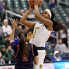 Missouri Southern's Destiny Cozart (1) scores over Panhandle State's Taylor Acosta (2) during their game on Tuesday night at Leggett & Platt.<br /> Globe | Laurie Sisk