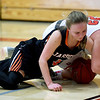 Jasper's Alexis Durman (3) and Carl Junction's Courtney Mertens (22) scramble for a loose ball during their game on Wednesday night at CJHS.<br /> Globe | Laurie SIsk