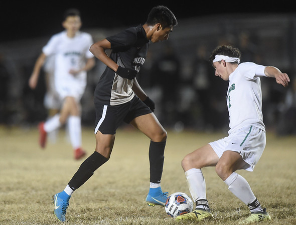 Neosho's Yahir Ruiz (10) gets past Parkview's Henry Smith for a first period goal during their sectional match on Tuesday night at NHS.<br /> Globe | Laurie Sisk
