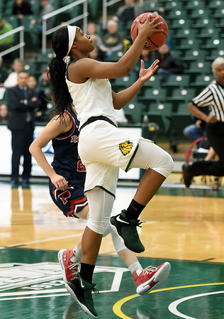 Missouri Southern's Destiny Cozart (1) gets past Panhandle State's Addison Munsch for a transition score during their game on Tuesday night at Leggett & Platt.<br /> Globe | Laurie Sisk