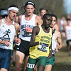 Missouri Southern's Gidieon Kimutai (211) passes Washburn's Jacob Klemz (485) during the Central Region Cross Country Championships on Saturday at MSSU.<br /> Globe | Laurie Sisk