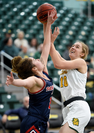 Missouri Southern's Zoe Campbell (10) puts up a shot as Panhandle State's Kelsea Illengo (24) defends during their game on Tuesday night at Leggett & Platt.<br /> Globe | Laurie Sisk