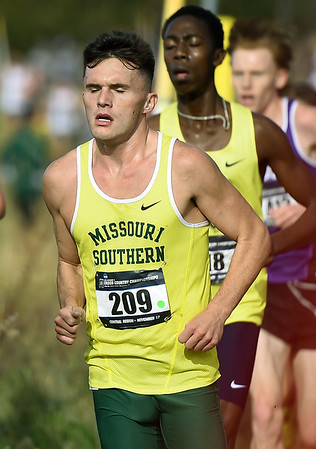 Missouri Southern's Cody Berry (209) keeps pace with the front of the pack during the Central Region Cross Country Championships on Saturday at MSSU.<br /> Globe | Laurie Sisk