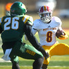 Pittsburg State's Lorenzo West (8) tries to get past Missouri Southern's John Ejizu (26) during their game on Saturday at Fred G. Hughes Stadium.<br /> Globe | Laurie Sisk