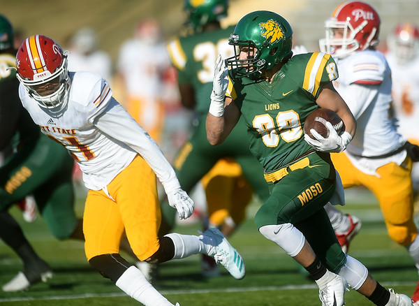 Missouri Southern's Cole Dunbar (89) tries to get past Pittsburg State's Keeyon Incle (21) during their game on Saturday at Fred G. Hughes Stadium.<br /> Globe | Laurie Sisk