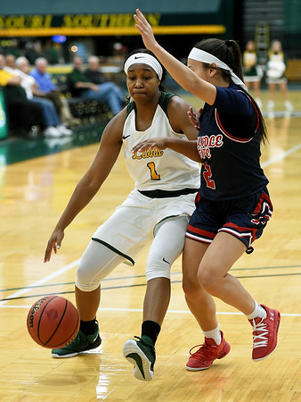 Missouri Southern's Destiny Cozart (1) tries to get past Panhandle State's Taylor Acosta (2) during their game on Tuesday night at Leggett & Platt.<br /> Globe | Laurie Sisk