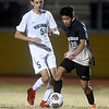 Neosho's Yahir Ruiz (20Gabriel Zapete (20) gets past Parkview's Jamal Ramadahn (5) during their sectional match on Tuesday night at NHS.<br /> Globe | Laurie Sisk