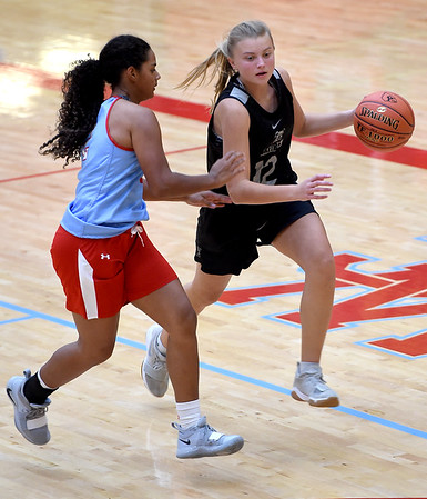 Carl Junction's Shila Winder (12) tires to get past Webb City's Keira Jackson during their scrimmage lst might at Webb City.<br /> Globe | Laurie SIsk