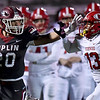 Joplin's Isaiah Davis (20) gets past Kirkwood's Mekhi Macklin (13) for a long gain during their playoff game on Friday night at Junge Stadium.<br /> Globe | Laurie Sisk