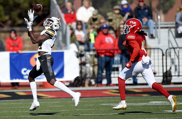 Missouri Western's Devon Holmes (84) betas Pittsburg State's William Bazzle for a 40-yard reception during their game on Saturday at PSU.<br /> Globe | Laurie Sisk