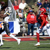 Missouri Western's Devon Holmes (84) betas Pittsburg State's William Bazzle for a 40-yard reception during their game on Saturday at PSU.<br /> Globe   Laurie Sisk