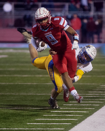 Webb City's Devrin Weathers tries to get away from Boliver's Andrew Bunn during Friday's game in Webb City.<br /> Globe | Roger Nomer