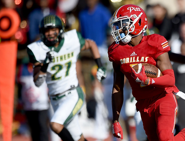 Pittsburg State's KiAnte Hardin returns a punt 54 yards to the Missouri Southern 1-yard line to set up PSU's first touchdown on Saturday at Carnie Smith Stadium. Also pictured is MSSU's Dylan Bolden (27).<br /> Globe   Laurie Sisk