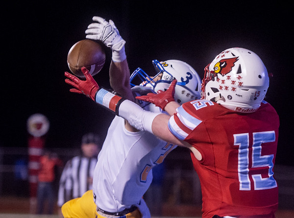 Boliver's Cooper Hitchcock knocks away a pass from Webb City's Cale McCallister in the endzone during Friday's game in Webb City.<br /> Globe | Roger Nomer