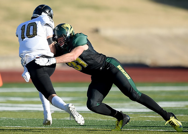 Missouri Southern's Colton Winder (31) tracks down Emporia State quarterback Braden Gleason (10) during their game on Saturday at Fred G. Hughes Stadium. <br /> Globe | Laurie Sisk