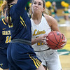 Missouri Southern's Amber Buch (11) tries to get past Graceland's Sydnee Crain (32) during their game on Wednesday night at Leggett & Platt.<br /> Globe | Laurie Sisk