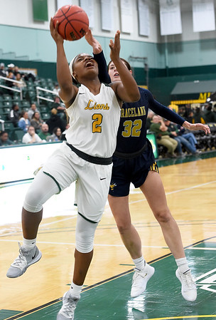 Missouri Southern's Chasidee Owens (2) drives past Graceland's Sydnee Crain (32) during their game on Wednesday night at Leggett & Platt.<br /> Globe | Laurie Sisk