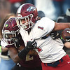 Joplin's Zach Westmoreland (1) tries to get past DeSmet's Denver Parker (2) during their Class 6 Championship game on Saturday in Columbia.<br /> Globe | Laurie Sisk