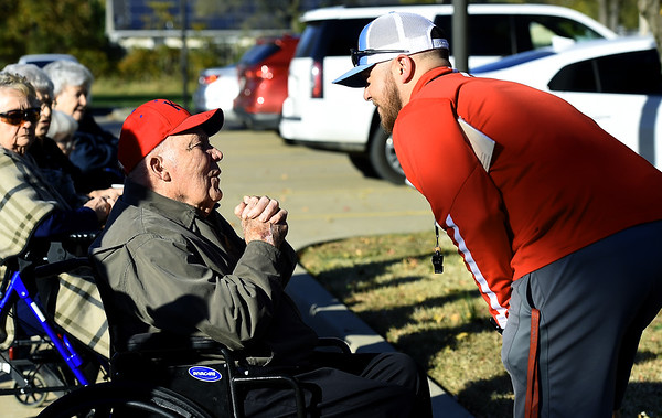 Former Kansas Jayhawk football player Bryan Sperry, left, chats with Webb City coach Aaron Snow before the Cardinals' junior varsity practice on Tuesday in front of residents of Foxberry Terrace Senior Living Center. Sperry lettered at both Kansas and Kansas State and played in KU's Orange Bowl appearance in the late 1940s.<br /> Laurie Sisk