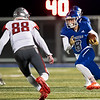 Carthage's Silas Templeman runs the ball with a gain of yards as he tries to get past Nixa's defender Isaac Forbis during their Class 5 District 6 championship game on Friday night at David Haffer Stadium in Carthage.<br /> Globe|Israel Perez