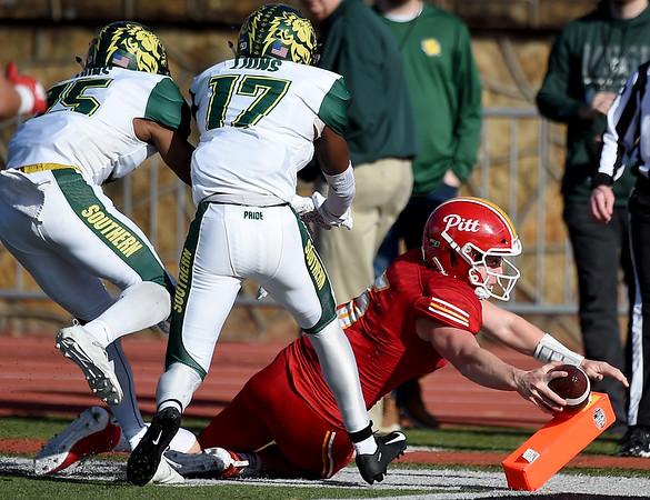 Pittsburg State quarterback Mak Sexton (5) reaches for the goal line as he is pushed out of bounds short of the touchdown by Missouri Southern's John Ejizu (15) and Fontez Davis (17) during their game on Saturday at Carnie Smith Stadium.<br /> Globe | Laurie SIsk