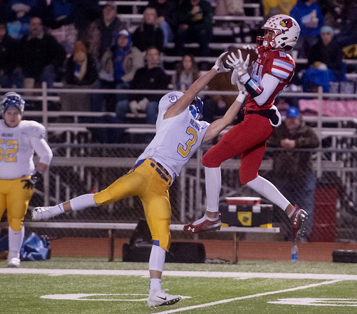 Webb City's Mekhl Garrard secures a catch over Boliver's Cooper Hitchcock during Friday's game at Webb City.<br /> Globe | Roger Nomer