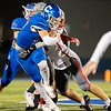 Carthage's Patrick Carlton pushes through the defense line for yards as he tries to break the tackle of Nixa's defender Tanner Grant during their Class 5 District 6 championship game on Friday night at David Haffer Stadium in Carthage.<br /> Globe|Israel Perez