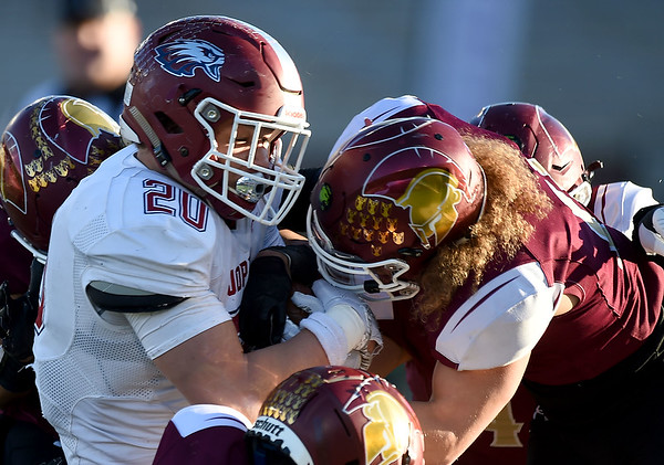 DeSmet's Lavon Jones, right, tries to strip the ball from Joplin runningback Isaiah Davis (20) during their Class 6 Championship game on Saturday in Columbia.<br /> Globe | Laurie Sisk