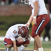 Senior offensive guard Hunter McCleary, right, console senior quarterback Blake Tash (12) after the Eagles fell to DeSmet at the 6A State Championship game on Saturday in Columbia.<br /> Globe | Laurie Sisk