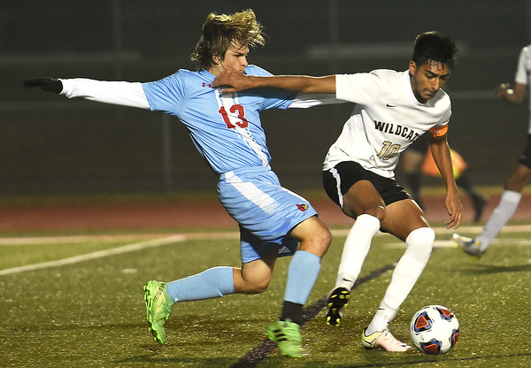 Neosho's Yahir Ruiz Medellin (10) tries to get past Webb City's Ian Edwards (13) during their Class 3 District 12 championship game on Wednesday night at Carl Junction.<br /> Globe | Laurie Sisk
