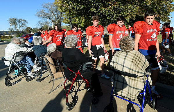 Webb City junior varsity football players meet residents of Foxberry Terrace Senior Living Center on Tuesday before their practice at Foxberry.<br /> Laurie Sisk