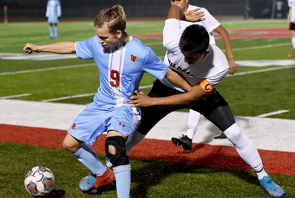 Webb City's Landon Black (9) and Neosho's Diego Vargas (13) battle for the ball during their Class 3 District 12 championship game on Wednesday night at Carl Junction.<br /> Globe | Laurie Sisk