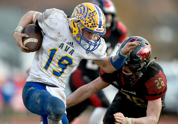 Lamar's Wyatt Hull (26) tries to stop Ava receiver Josh Bray (19) during their playoff game on Saturday at Lamar.<br /> Globe | Laurie Sisk