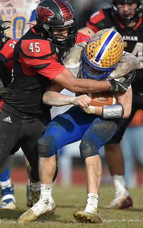 Lamar's Justin Walker (45) tries to bring down Ava quarterback Nate Swofford during their playoff game on Saturday at Lamar. <br /> Globe   Laurie Sisk