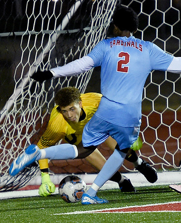 Webb City goalie Alexander Gooch dives for the ball as teammate Ignatius Mathenge (2) attempts to clear it during their Class 3 District 12 championship game on Wednesday night at Carl Junction.<br /> Globe   Laurie Sisk