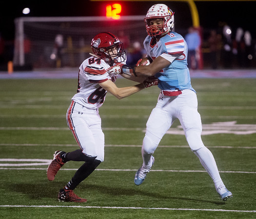 Webb City's Devrin Weathers gets away from McDonald County's Kyle Hook during Friday's game in Webb City.<br /> Globe | Roger Nomer