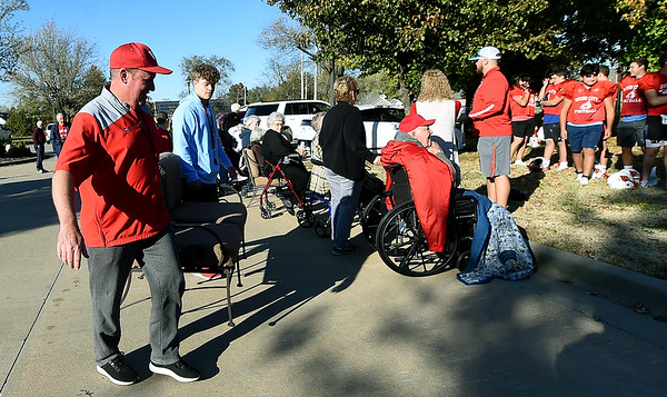 From the left: Webb City coach Dean Derryberry and player Caden Myers help bring out seating for residents of Foxberry Terrace Senior Living Center before a practice exhibition of Cardinal junior varsity players on Tuesday at Foxberry.<br /> Laurie Sisk