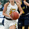 Missouri Southern's Morgan Brightwell (24) drives past Graceland's Calesse Bair (4) during their game on Wednesday night at Leggett & Platt.<br /> Globe | Laurie Sisk