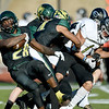 Missouri Southern runningback Josh Mercer (28) spins out of a crowd for extra yards during the Lions game against Emporia State on Saturday at Fred G. Hughes Stadium. Also pictured is ESU's Lawson Holbert (1.)<br /> Globe | Laurie Sisk