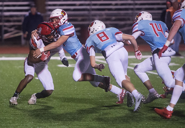 McDonald County's Trent Alik runs into a line of Webb City defenders, including Brentan Wilson (7), Cade Wilson (8) and Gavin Stowell (14) during Friday's game in Webb City.<br /> Globe | Roger Nomer