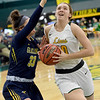 Missouri Southern's Zoe Campbell (10) drives past Graceland's Kailey Boden (33) during their game on Wednesday night at Leggett & Platt.<br /> Globe | Laurie Sisk
