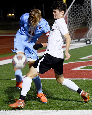 Webb City's Jacob Bundy (11) and Neosho's Dylan Collins battle for the ball during their Class 3 District 12 championship game on Wednesday night at Carl Junction.<br /> Globe | Laurie Sisk